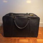 Valise vintage en cuir noir
